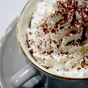 a cup of hot chocolate covered with whipped cream